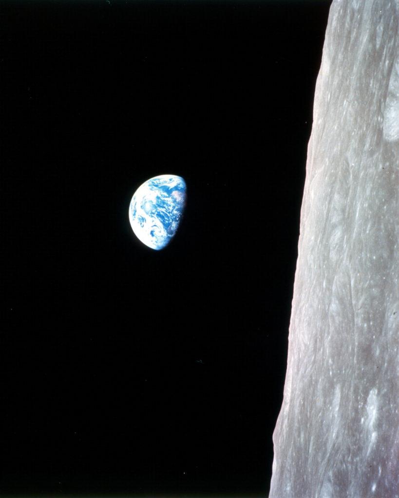 Earth rising above the Moon horizon